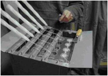 Изображение - Производство свечей как бизнес stanok-otrezaet-svechi
